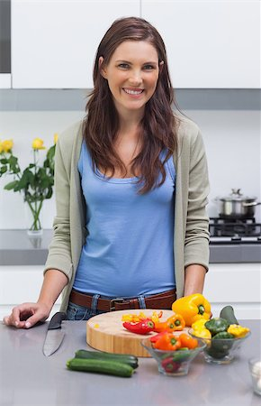 pimento - Attractive woman standing in her kitchen in front of sliced vegetables Stock Photo - Budget Royalty-Free & Subscription, Code: 400-06888318