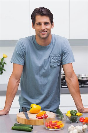 pimento - Attractive man standing in his kitchen in front of sliced vegetables Stock Photo - Budget Royalty-Free & Subscription, Code: 400-06888312