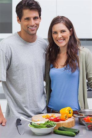 pimento - Cheerful couple smiling at camera and preparing vegetables in their kitchen Stock Photo - Budget Royalty-Free & Subscription, Code: 400-06888323