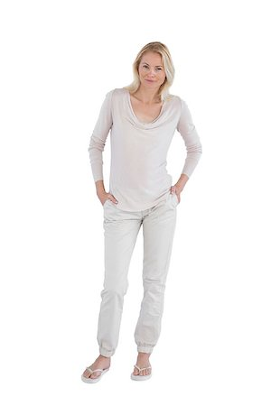 female white background full body - Smiling woman with hands in pockets on a white background Stock Photo - Budget Royalty-Free & Subscription, Code: 400-06889190