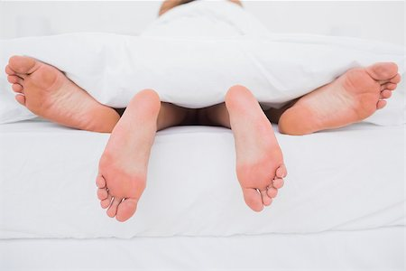 Rear view of a couple having sex in bed Stock Photo - Budget Royalty-Free & Subscription, Code: 400-06889900