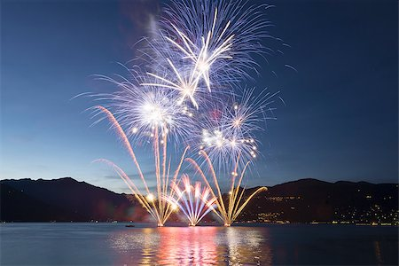 silhouette of firework - Fireworks on the Lake Maggiore, Luino - Italy Stock Photo - Budget Royalty-Free & Subscription, Code: 400-06880744