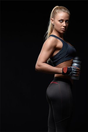 Athletic girl with a shaker Stock Photo - Budget Royalty-Free & Subscription, Code: 400-06891896