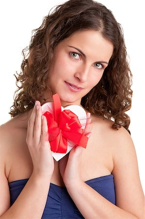 sexy couple chocolate - Woman holds a heart shaped box with her hands, isolated in white Stock Photo - Budget Royalty-Free & Subscription, Code: 400-06918256