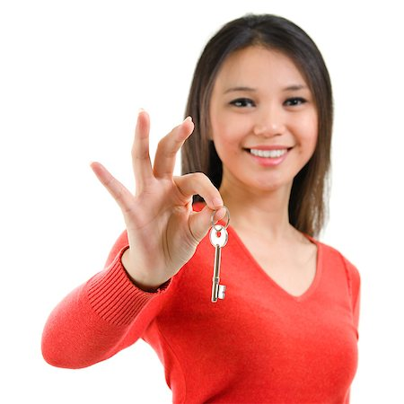 Attractive young woman holding her first own house key isolated on white background. Beautiful mixed race Caucasian Southeast Asian woman model. Stock Photo - Budget Royalty-Free & Subscription, Code: 400-06918404