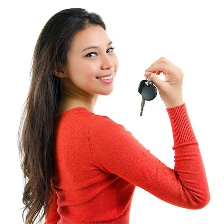 Attractive young woman holding her first own car key isolated on white background. Beautiful mixed race Caucasian Southeast Asian woman model. Stock Photo - Budget Royalty-Free & Subscription, Code: 400-06918403