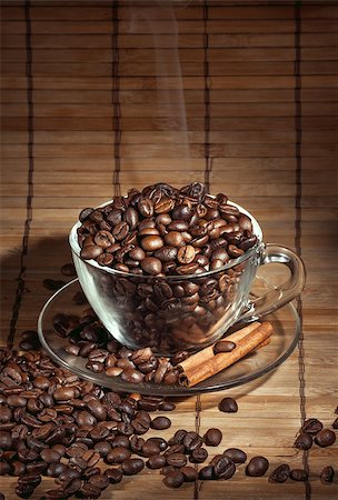 Steaming cup of coffee, cinnamon sticks and a coffee beans Stock Photo - Budget Royalty-Free & Subscription, Code: 400-06911026