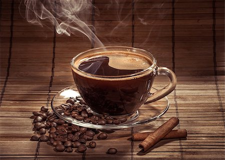 Steaming cup of coffee, cinnamon sticks and a coffee beans Stock Photo - Budget Royalty-Free & Subscription, Code: 400-06911027