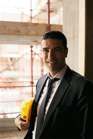 diego_cervo (artist) - Professional people at work, portrait of happy and confident architect with safety helmet in construction site, smiling at camera Stock Photo - Budget Royalty-Free & Subscription, Code: 400-06912762