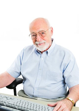 Senior man sitting at a desktop computer.  Isolated on white. Stock Photo - Budget Royalty-Free & Subscription, Code: 400-06926935
