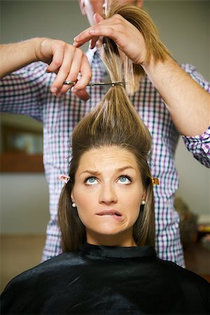 diego_cervo (artist) - female client in hairdresser shop uncertain about cutting hair and biting lips Stock Photo - Budget Royalty-Free & Subscription, Code: 400-06928119