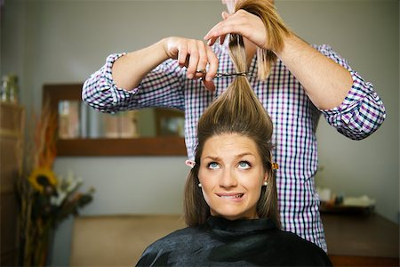 diego_cervo (artist) - female client in hairdresser shop uncertain about cutting hair and biting lips Stock Photo - Budget Royalty-Free & Subscription, Code: 400-06928386
