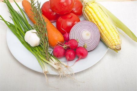 fresh vegetables and herbs on a plate cooking raw ingredients on kitchen Stock Photo - Budget Royalty-Free & Subscription, Code: 400-06921940