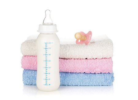 Baby bottle, pacifier and towels. Isolated on white background Stock Photo - Budget Royalty-Free & Subscription, Code: 400-06922299