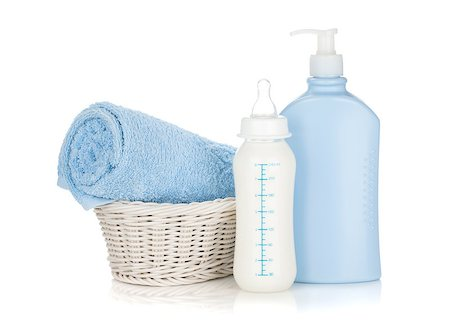 Baby milk bottle, shampoo and towel. Isolated on white background Stock Photo - Budget Royalty-Free & Subscription, Code: 400-06922290