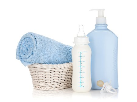 Baby milk bottle, pacifier, shampoo and towel. Isolated on white background Stock Photo - Budget Royalty-Free & Subscription, Code: 400-06922291