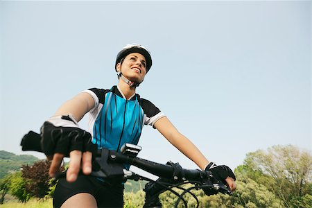 diego_cervo (artist) - young woman training on mountain bike and cycling in park. Copy space, low angle view Stock Photo - Budget Royalty-Free & Subscription, Code: 400-06922980