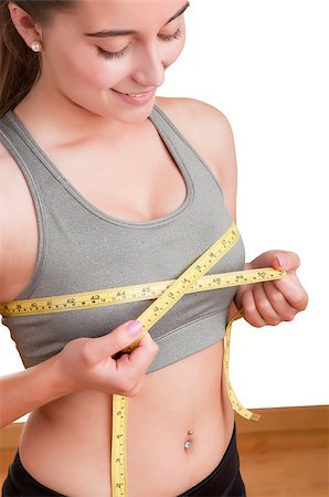 Sporty woman measuring up her chest, isolated in white Stock Photo - Budget Royalty-Free & Subscription, Code: 400-06923676
