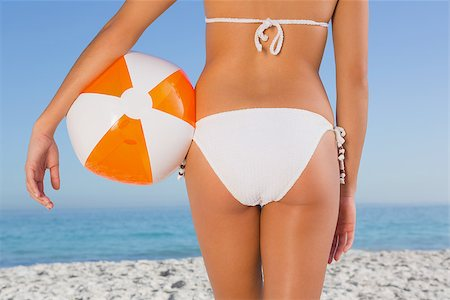simsearch:400-04002563,k - Close up of perfect young womans buttocks with beach ball on the beach Stock Photo - Budget Royalty-Free & Subscription, Code: 400-06930026
