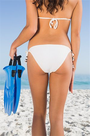 simsearch:400-04002563,k - Perfect feminine buttocks of slim young woman holding fins Stock Photo - Budget Royalty-Free & Subscription, Code: 400-06930037
