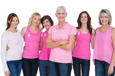 Enthusiastic women posing with pink tops for breast cancer on white background Stock Photo - Budget Royalty-Free & Subscription, Code: 400-06932874