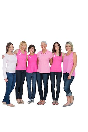 Smiling women posing with pink tops for breast cancer awareness on white background Stock Photo - Budget Royalty-Free & Subscription, Code: 400-06932871