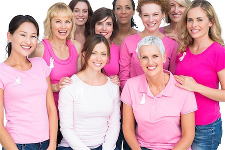 Voluntary pretty women posing and wearing pink for breast cancer on white background Stock Photo - Budget Royalty-Free & Subscription, Code: 400-06932888