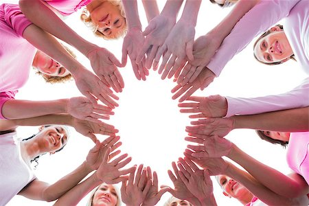 Happy women in circle wearing pink for breast cancer on white background Stock Photo - Budget Royalty-Free & Subscription, Code: 400-06932894