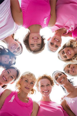 Group of women in circle wearing pink for breast cancer on white background Stock Photo - Budget Royalty-Free & Subscription, Code: 400-06932896