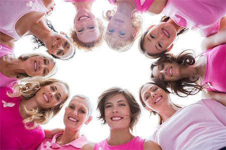 Group of happy women in circle wearing pink for breast cancer on white background Stock Photo - Budget Royalty-Free & Subscription, Code: 400-06932897