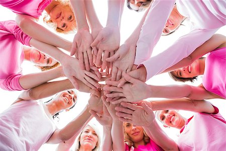 Diverse women smiling in circle wearing pink for breast cancer on white background Stock Photo - Budget Royalty-Free & Subscription, Code: 400-06932893