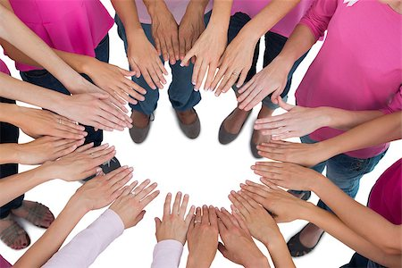 Hands joined in circle wearing pink for breast cancer on white background Stock Photo - Budget Royalty-Free & Subscription, Code: 400-06932902