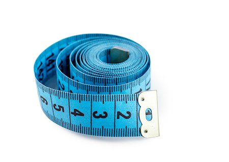 Closeup view of blue measuring tape isolated over white background Stock Photo - Budget Royalty-Free & Subscription, Code: 400-06946816