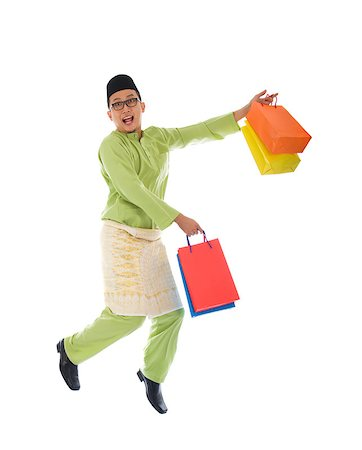 Traditional Malay male shopping and jumping in joy during hari raya ramadan festival Stock Photo - Budget Royalty-Free & Subscription, Code: 400-06948597