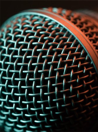 Macro photo of a vocal microphone lit with stage lights. Stock Photo - Budget Royalty-Free & Subscription, Code: 400-06954070