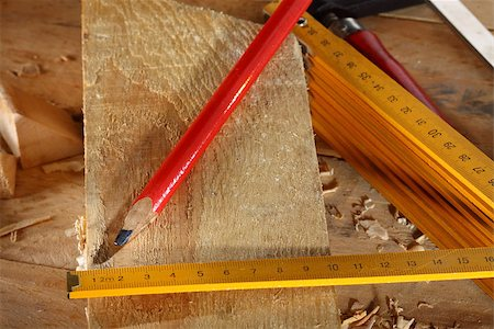 Carpenter's pencil and wooden meter on workshop Stock Photo - Budget Royalty-Free & Subscription, Code: 400-07046047