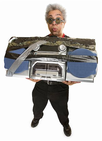 Man having difficulty carrying large 1980s portable radio Stock Photo - Budget Royalty-Free & Subscription, Code: 400-07042121