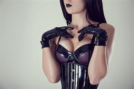 Close-up shot of female breasts in latex bra, studio shot Stock Photo - Budget Royalty-Free & Subscription, Code: 400-07055016