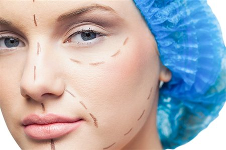Close up on pretty young patient with dotted lines on the face before surgery Stock Photo - Budget Royalty-Free & Subscription, Code: 400-07060394