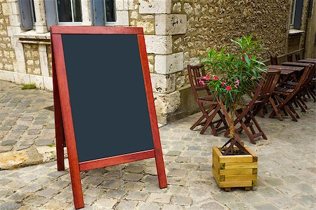 street view of a Restaurant's terrace with blackboard Stock Photo - Budget Royalty-Free & Subscription, Code: 400-07087702