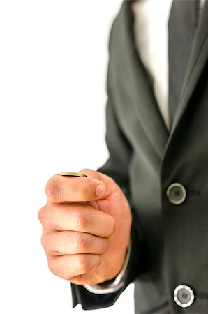 Detail of businessman tossing a coin. Stock Photo - Budget Royalty-Free & Subscription, Code: 400-07089254