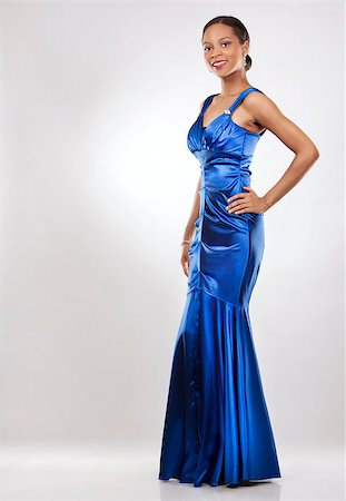 beautiful woman wearing blue evening dress on light background Stock Photo - Budget Royalty-Free & Subscription, Code: 400-07093921