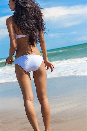 simsearch:400-04002563,k - Rear view of a sexy young brunette woman or girl wearing a white bikini on a deserted tropical beach with a blue sky Stock Photo - Budget Royalty-Free & Subscription, Code: 400-07114664