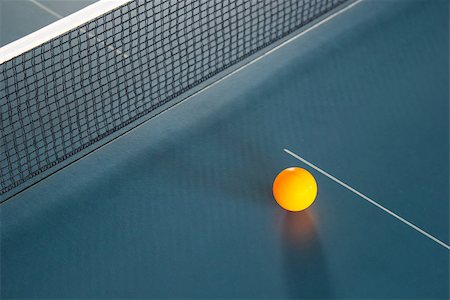 Orange table tennis ball on blue table Stock Photo - Budget Royalty-Free & Subscription, Code: 400-07115785