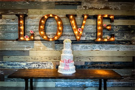 Image of a wedding cake with the word love as sinage on a rustic background Stock Photo - Budget Royalty-Free & Subscription, Code: 400-07111194