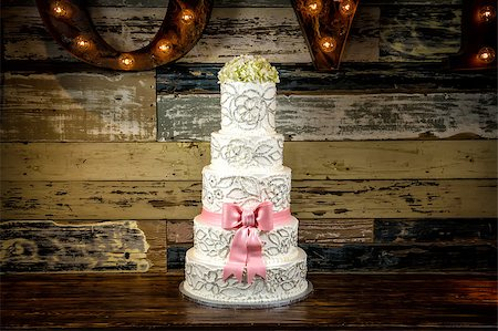 Image of a beautiful wedding cake with a rustic background Stock Photo - Budget Royalty-Free & Subscription, Code: 400-07111195