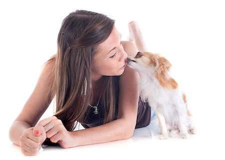 dog kissing girl - young girl and chihuahua in front of white background Stock Photo - Budget Royalty-Free & Subscription, Code: 400-07124264
