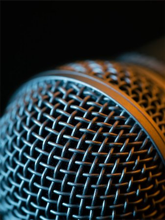 Macro photo of a vocal microphone in low light lit with stage lights. Stock Photo - Budget Royalty-Free & Subscription, Code: 400-07125010