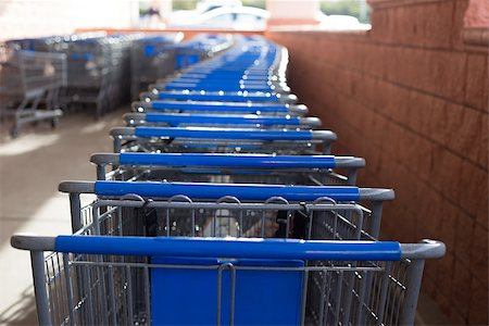 empty shopping cart - Many blue and gray shopping carts lined up and ready to go shopping. Stock Photo - Budget Royalty-Free & Subscription, Code: 400-07122939
