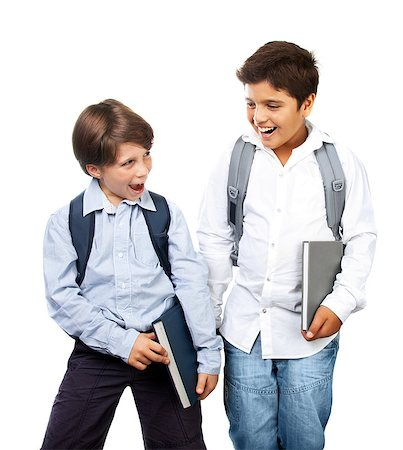 Two happy schoolboys isolated on white background, cheerful teenagers laughing, cute smiling kids holding textbooks, best friends standing in studio, back to school, education and knowledge concept Stock Photo - Budget Royalty-Free & Subscription, Code: 400-07123457